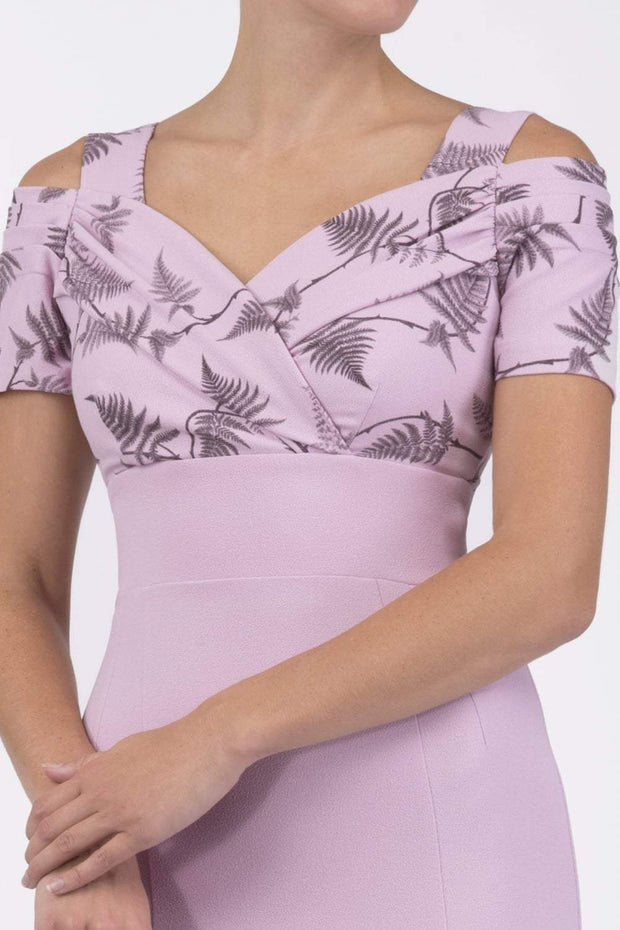 Model wearing the Diva Amorette pencil dress with cold shoulder and pleated detailing on the arms in dawn pink fern front image