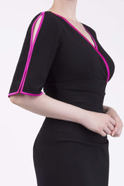 Model wearing the Diva Andorra Pencil dress with V neckline in black and fuchsia front image