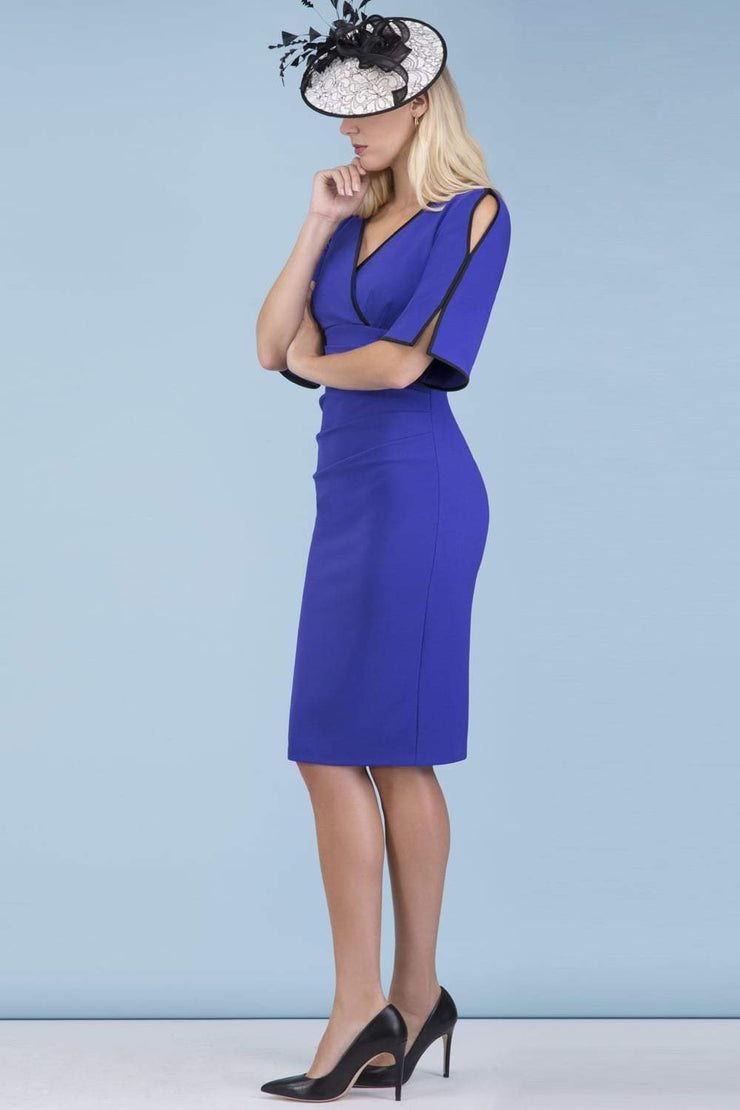 Model wearing the Diva Andorra Pencil dress with V neckline in spectrum indigo and black front image