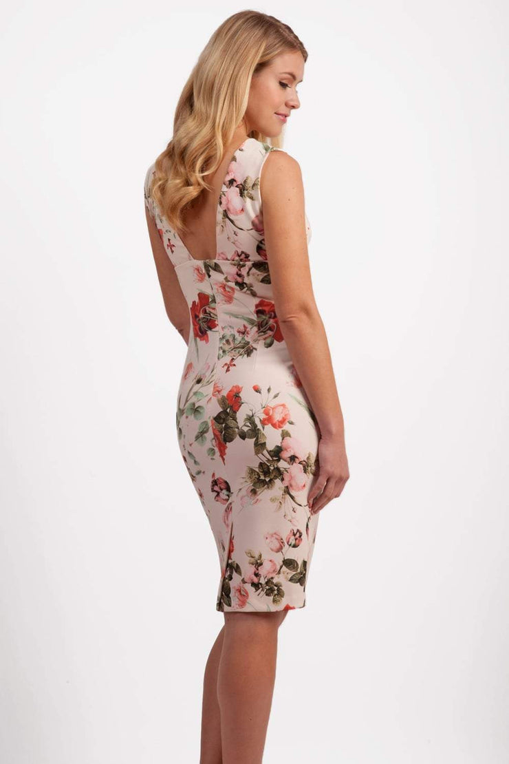 Model wearing the Diva Athens Print dress sleeveless with plunging neckline, semi square open back in rose blush print back image