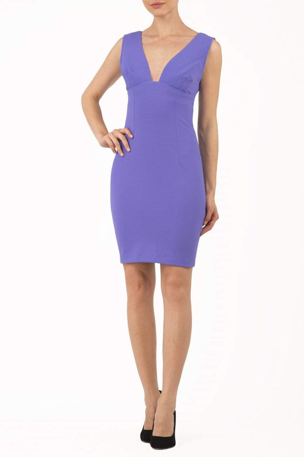 Model wearing the Diva Athens Short dress sleeveless with plunging neckline, semi square open back in fusion indigo front image