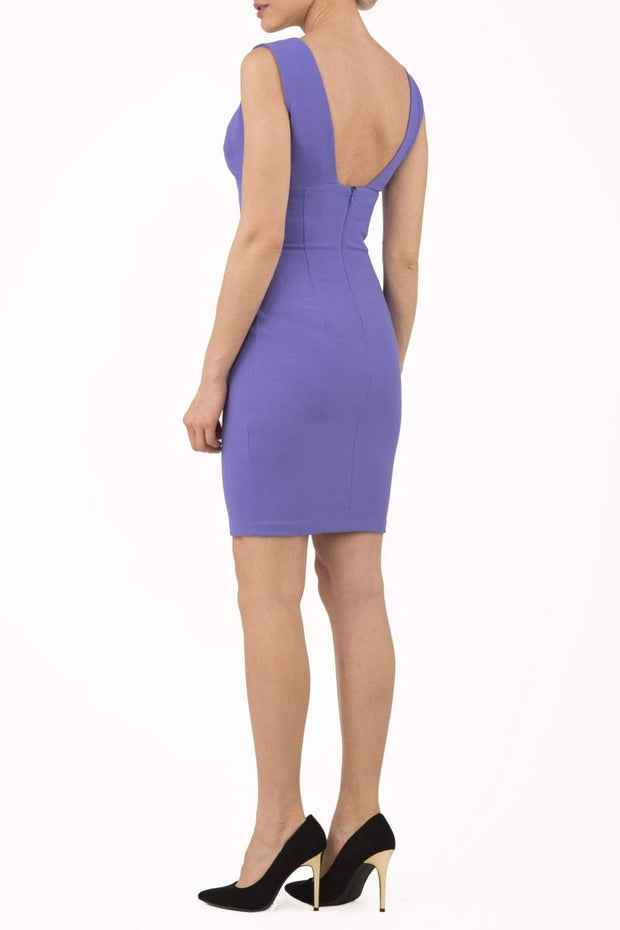 Model wearing the Diva Athens Short dress sleeveless with plunging neckline, semi square open back in fusion indigo back image