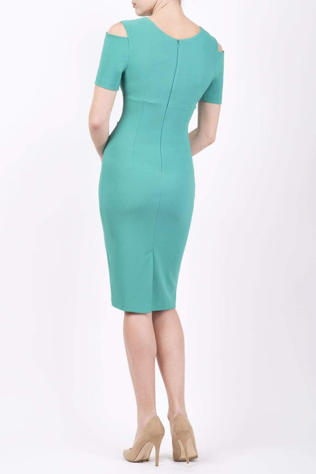 Model wearing the Diva Atlas Pencil dress with round neckline short sleeved dress with small cutouts on the shoulders in emerald green back image