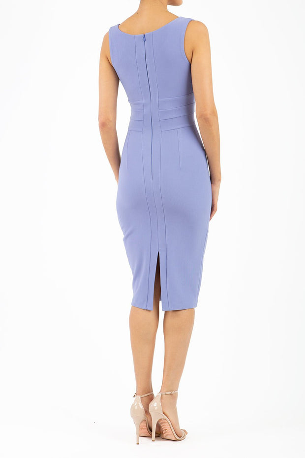 Model wearing the Diva Banbury gathered dress in bodycon pencil dress design in vista blue back image