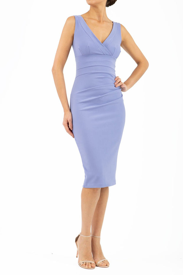 Model wearing the Diva Banbury gathered dress in bodycon pencil dress design in vista blue front image
