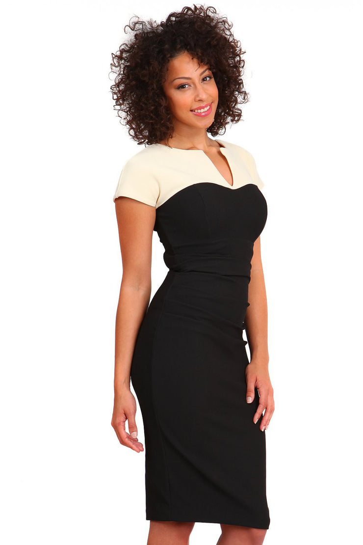 Model wearing the Diva Bryony Contrast dress with contrasting top and exposed zip at the back in black and vanilla cream front image