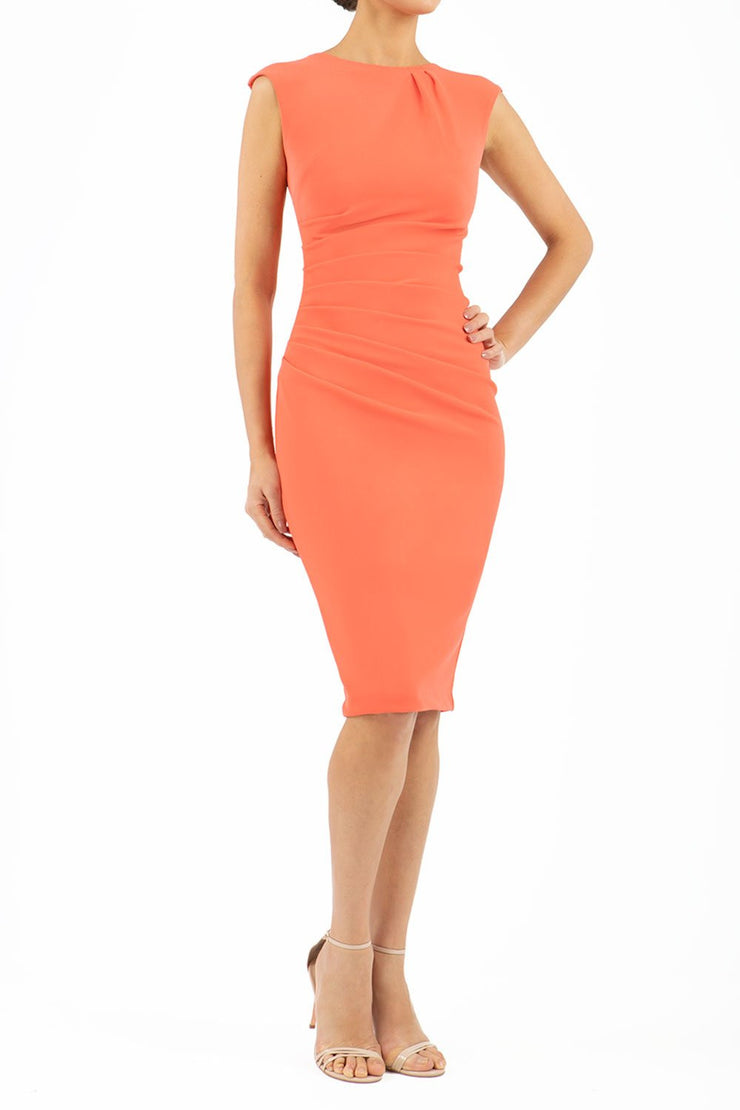 Model wearing the Diva Carla Pencil dress in ribbed super stretch fabric in sea coral front image