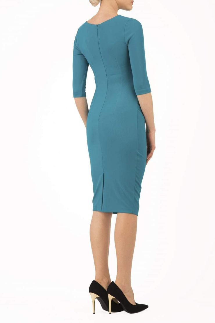 Model wearing the Diva Carlotta Pencil dress with pleat detail at the neckline and across the front in mosaic blue back image