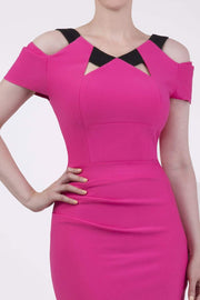Model wearing the Diva Carolina Colour block dress with contrast colour neck detail in hibiscus fushia and black front image
