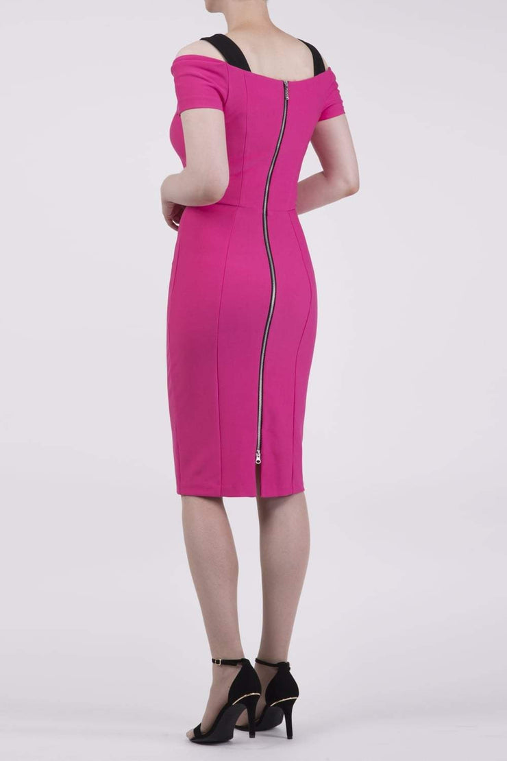 Model wearing the Diva Carolina Colour block dress with contrast colour neck detail in hibiscus fushia and black back image