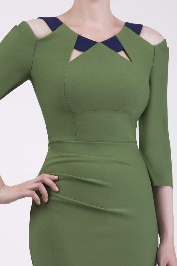 Model wearing the Diva Carolina ¾ sleeve Dress with cut out neckline detail in vineyard green and navy front image