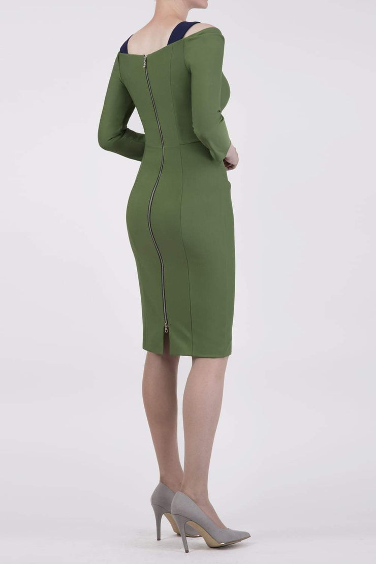 Model wearing the Diva Carolina ¾ sleeve Dress with cut out neckline detail in vineyard green and navy back image