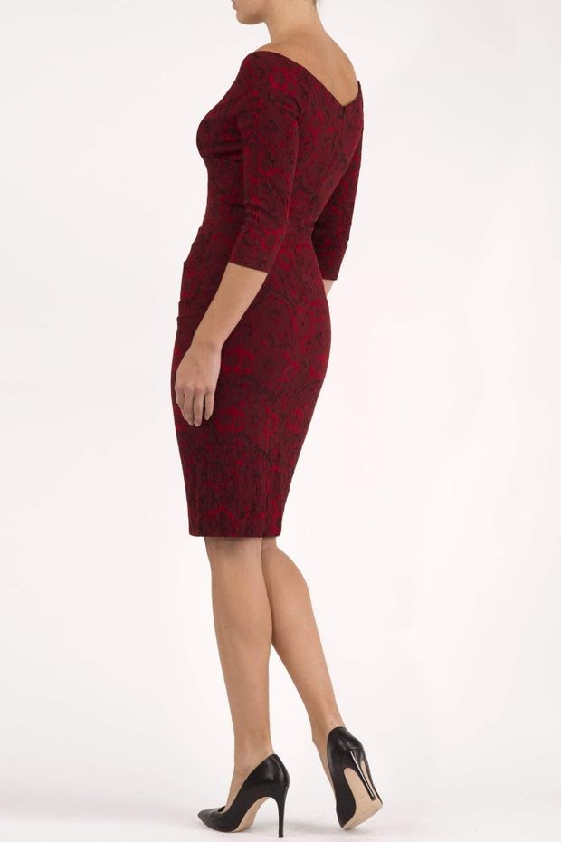 Model wearing the Diva Catherine Jacquard dress with overlapping bodice in circle red back image