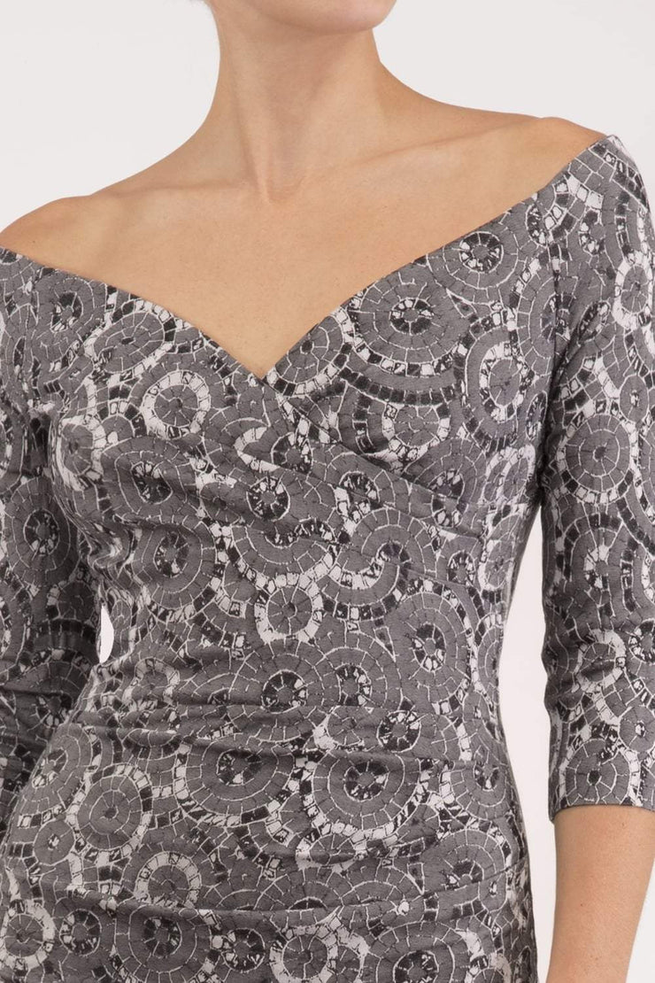 Model wearing the Diva Catherine Jacquard dress with overlapping bodice in circle grey front image