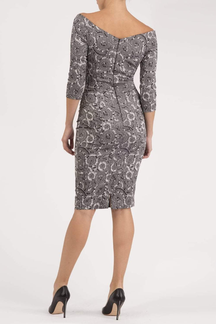 Model wearing the Diva Catherine Jacquard dress with overlapping bodice in circle grey back image