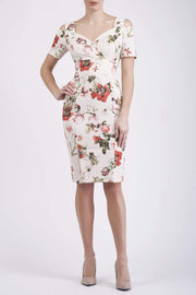 Model wearing the Diva Cindy Print dress with shoulder straps to create cold look in rose blush print front image