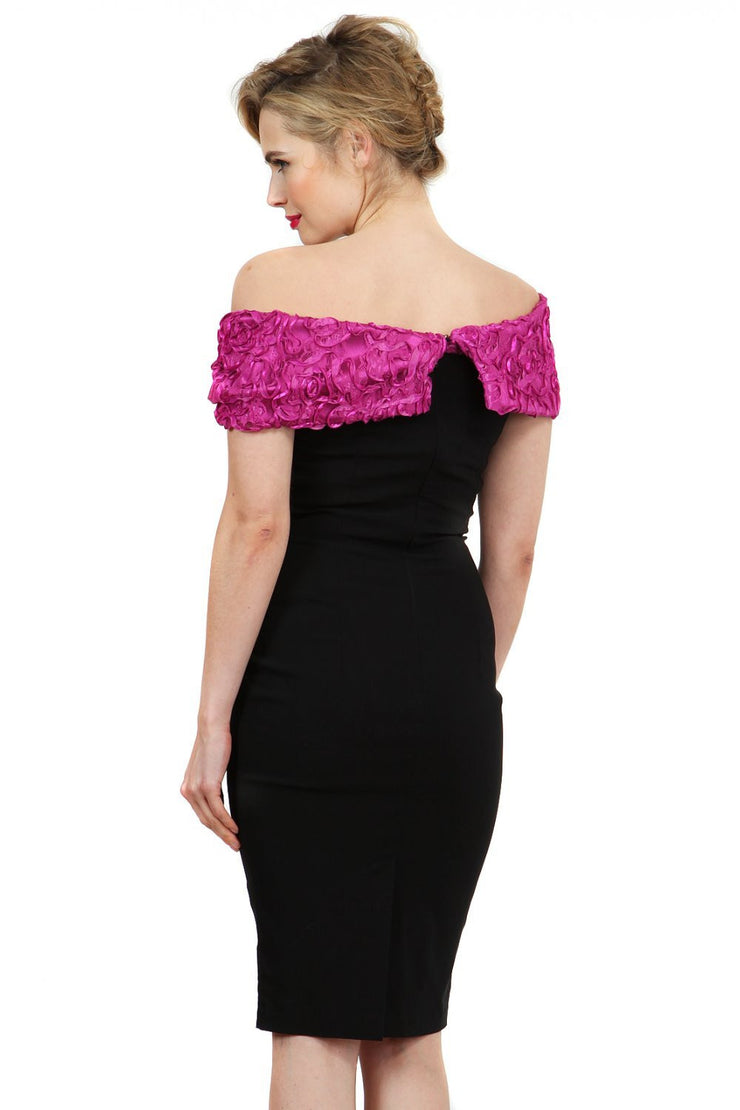 Model wearing the Diva Cornelli Perth dress with cornelli lace top, off shoulder design and diamanté brooch in black and fushia pink back image