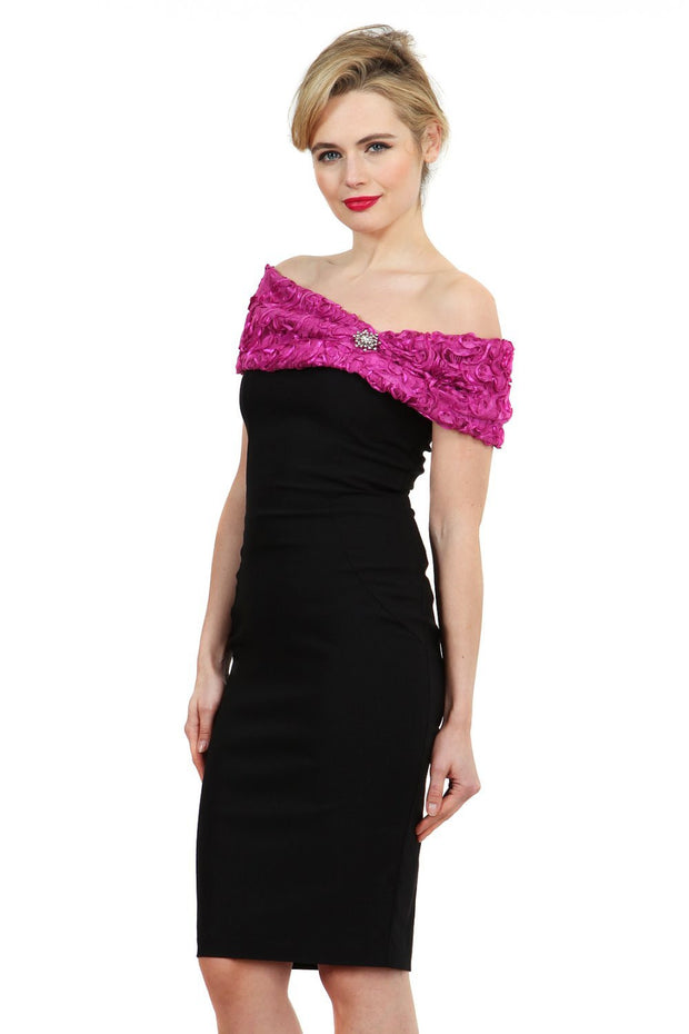 Model wearing the Diva Cornelli Perth dress with cornelli lace top, off shoulder design and diamanté brooch in black and fushia pink front image
