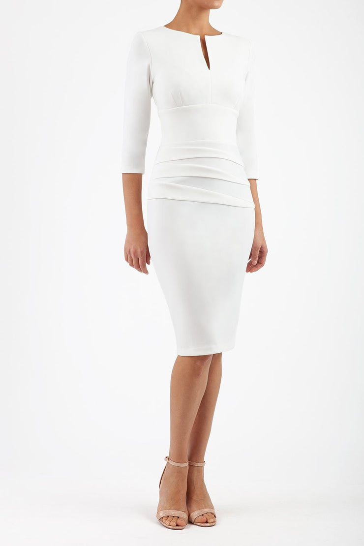 Model wearing the Diva Daphne ¾ Sleeved dress with pleat detail across the hips and ¾ sleeve length in ivory cream front