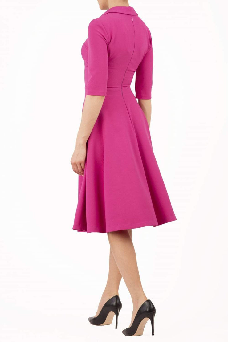 Model wearing the Diva Annette Swing Dress with V shaped neckline with zip detail in fuschia pink back image