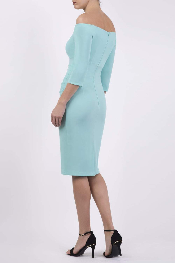Model wearing the Diva Astra pencil dress with off shoulder design in mint green back image