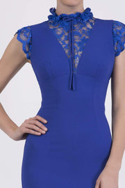 Model wearing the Diva Athens lace pencil dress with gathered lace trim around high neck and shoulder edges in riviera blue front