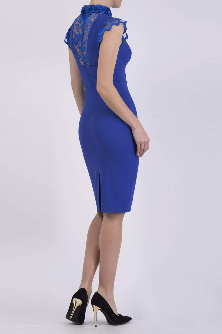 Model wearing the Diva Athens lace pencil dress with gathered lace trim around the neck and shoulder edges in riviera blue back image