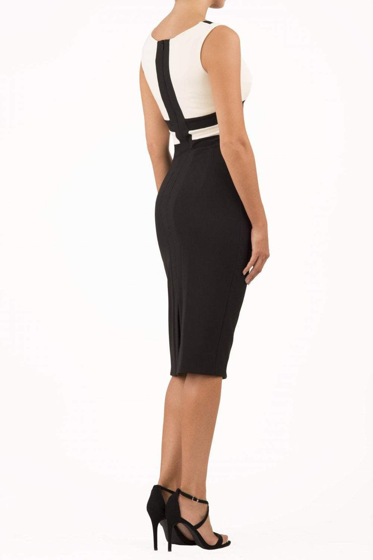 Model wearing the Diva Banbury Colour block dress with bust panels in contrast and pleating across the front in black and vanilla cream back image