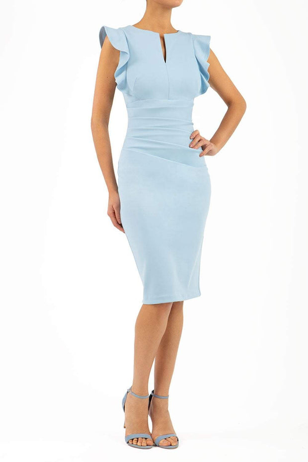 model wearing diva catwalk Bodiam Bodycon Pencil Dress with frill sleeves in knee length and pleating across the tummy in dream blue front