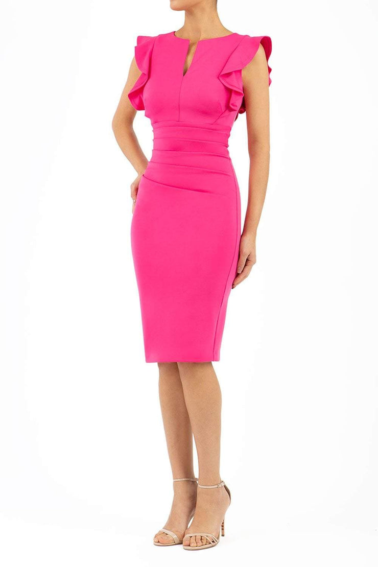 model wearing diva catwalk Bodiam Bodycon Pencil Dress with frill sleeves in knee length and pleating across the tummy in pink front