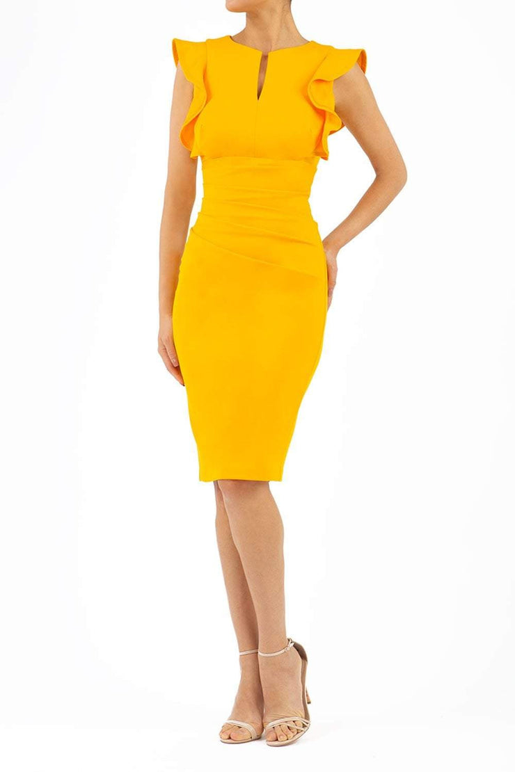 model wearing diva catwalk Bodiam Bodycon Pencil Dress with frill sleeves in knee length and pleating across the tummy in yellow front