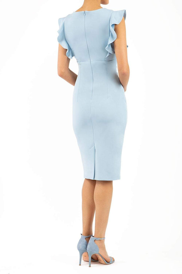 model wearing diva catwalk Bodiam Bodycon Pencil Dress with frill sleeves in knee length and pleating across the tummy in dream blue back