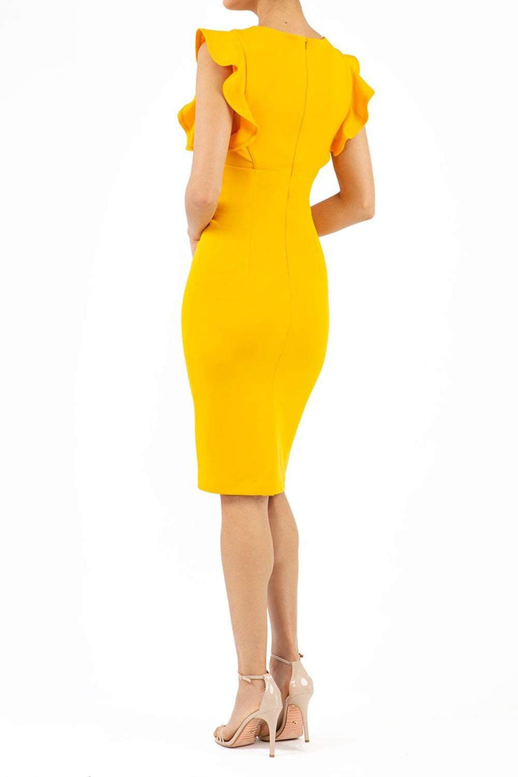 model wearing diva catwalk Bodiam Bodycon Pencil Dress with frill sleeves in knee length and pleating across the tummy in yellow back