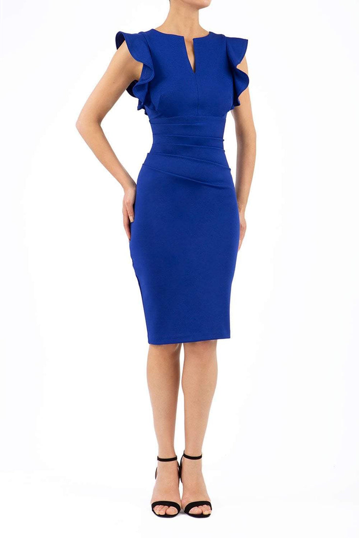 model wearing diva catwalk Bodiam Bodycon Pencil Dress with frill sleeves in knee length and pleating across the tummy in cobalt blue front