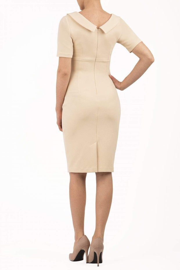 Model wearing the Diva Camille Marvel, pleat detail across front, fold at neckline in beige back image