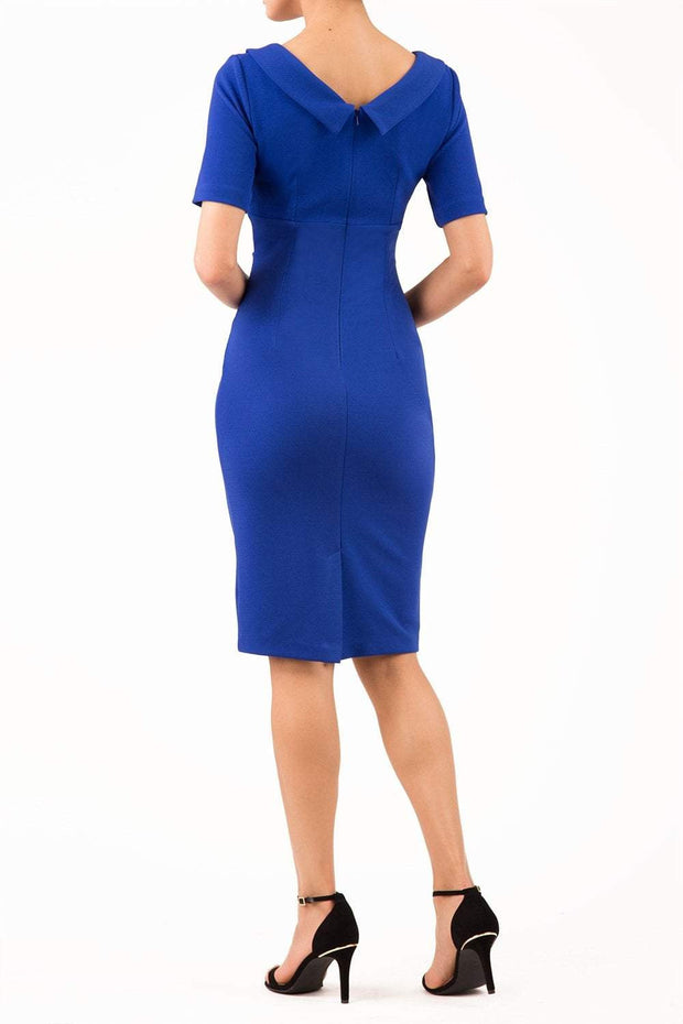 Model wearing the Diva Camille Marvel, pleat detail across front, fold at neckline in cobalt blue back image