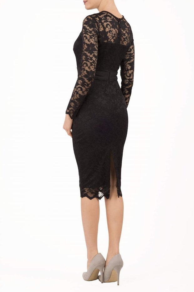 Model wearing the Diva Cherrie Lace Pencil dress with long sleeves and round neck in black back image