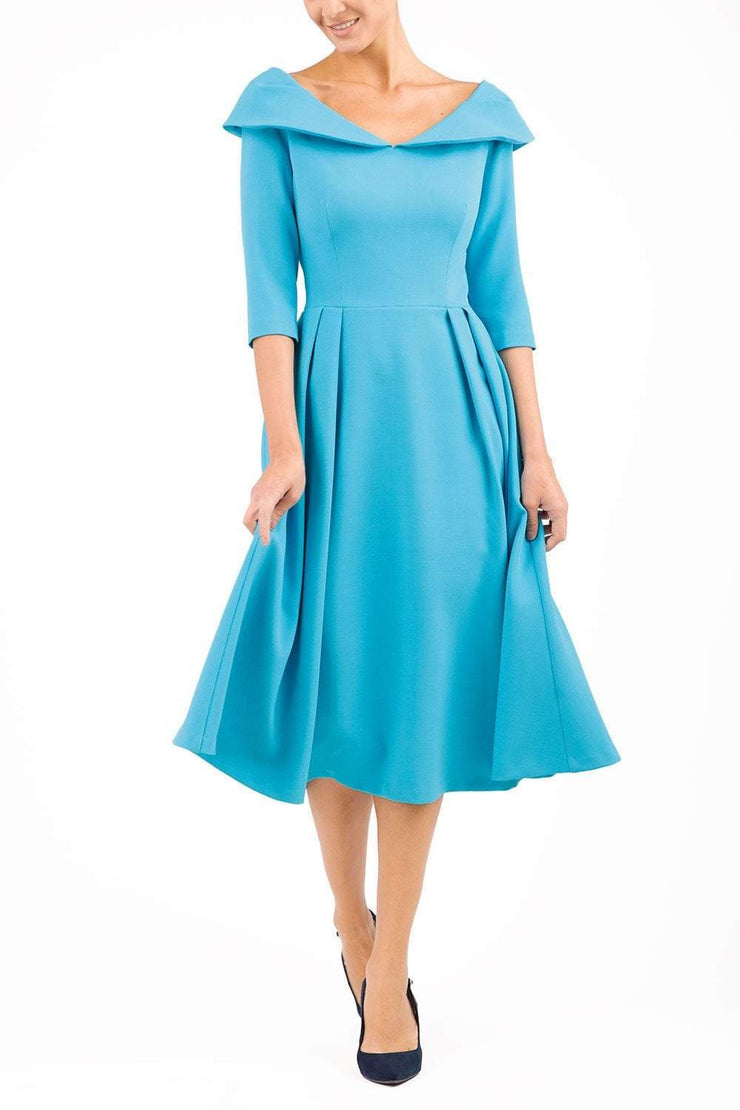 Model wearing Diva Catwalk Chesterton Sleeved dress with oversized collar detail and a-line swing pleated skirt in colour azure blue front