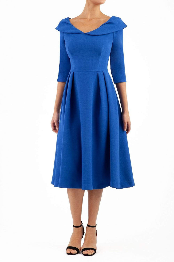 Model wearing Diva Catwalk Chesterton Sleeved dress with oversized collar detail and a-line swing pleated skirt in colour royal blue front