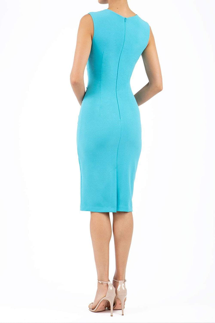 Model wearing the Diva Clara Pencil dress with vertical pleat detailing at bust sleeveless design in celeste blue back image