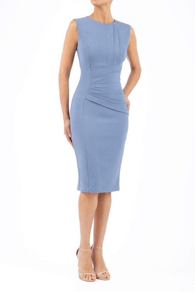 Model wearing the Diva Clara Pencil dress with vertical pleat detailing at bust sleeveless design in stone blue front image