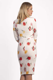 Model wearing the Diva Cynthia Floral Print dress with pleating across the front in buttercup print back image