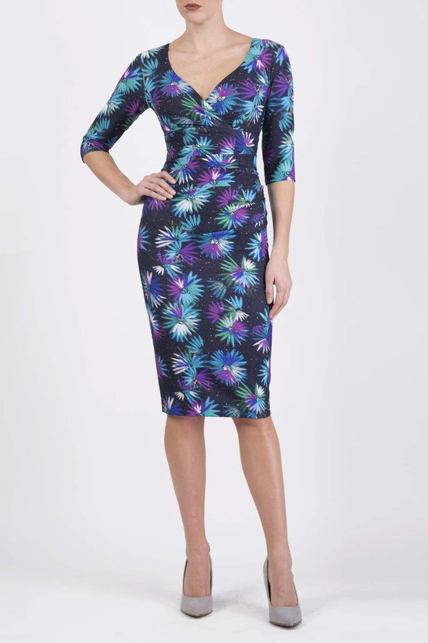 Model wearing the Diva Cynthia Floral Print dress with pleating across the front in Floral splash print front image