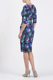 Model wearing the Diva Cynthia Floral Print dress with pleating across the front in Floral splash print back image