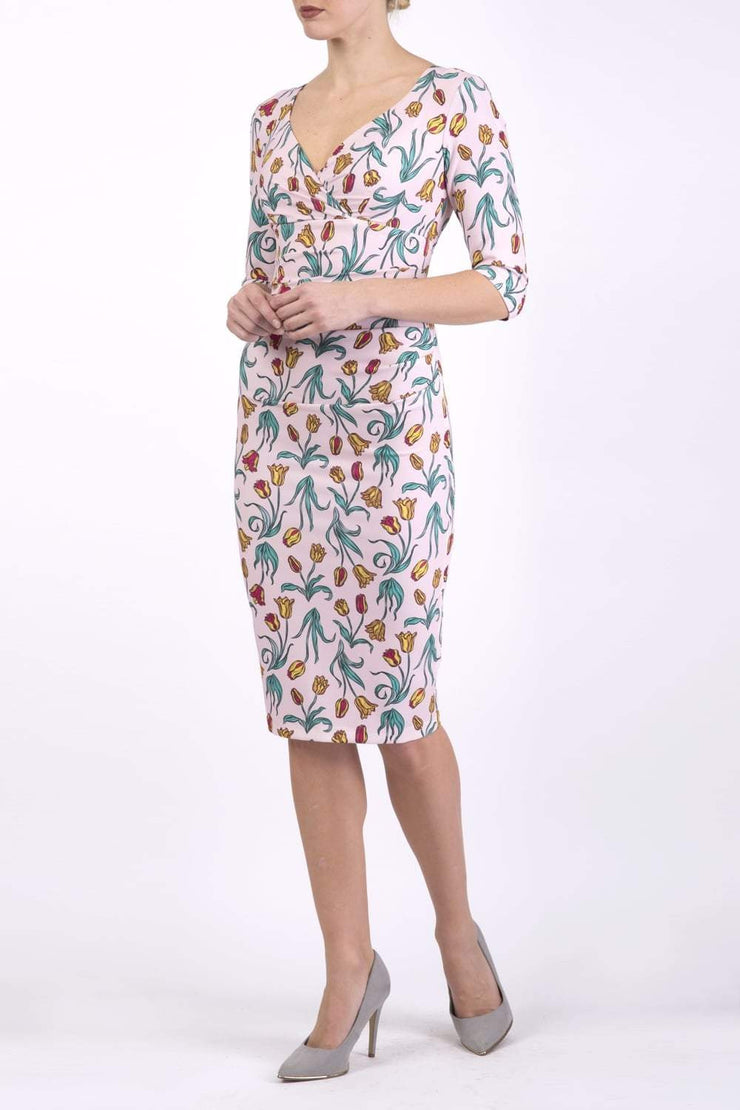 Model wearing the Diva Cynthia Floral Print dress with pleating across the front in linear tulip print front image