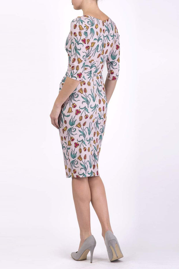 Model wearing the Diva Cynthia Floral Print dress with pleating across the front in linear tulip print back image