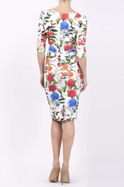 Model wearing the Diva Cynthia Floral Print dress with pleating across the front in Eden print back image