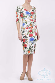 Model wearing the Diva Cynthia Floral Print dress with pleating across the front in Eden print front image