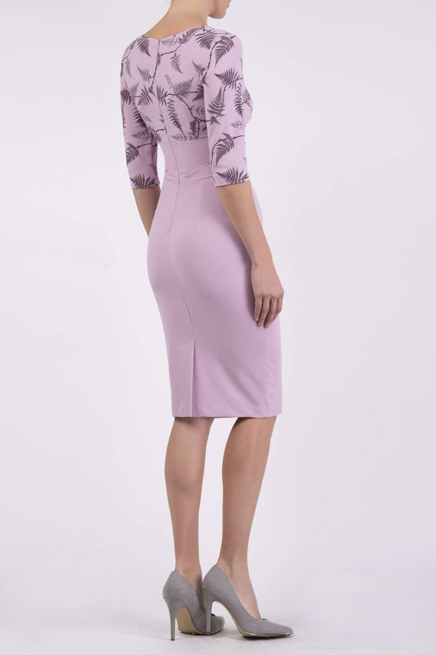 Model wearing the Diva Cynthia Print Contrast dress with pleating across the front in dawn pink fern back image