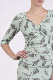 Model wearing the Diva Cynthia Print dress with pleating across the front in deco green fern front image